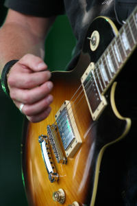 Strumming Gibson Les Paul Electric Guitar